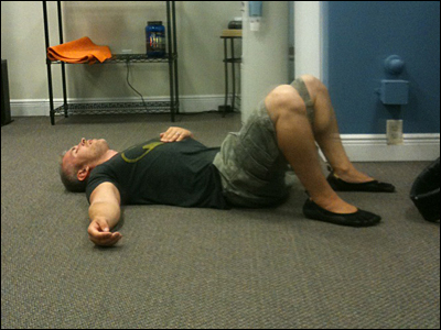 Drew Baye on the floor after a high intensity training workout