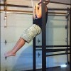 Drew Baye performing chin ups on the UXS