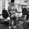 Mike Mentzer curling a 225 pound barbell