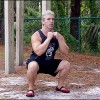 Drew Baye demonstrating a bodyweight squat