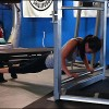 Kasey performing push-ups on the UXS bodyweight exercise station