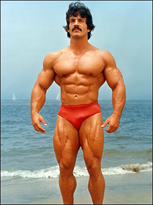Mike Mentzer posing on the beach