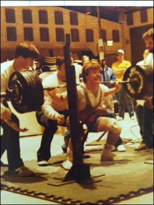 Doug Holland squatting