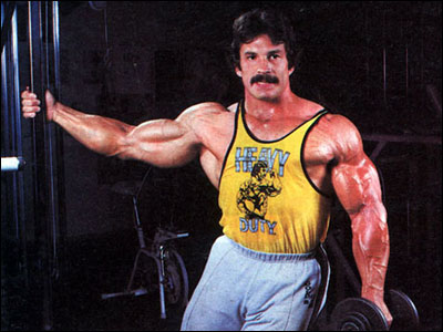 Mike Mentzer performing unilateral dumbbell lateral raises