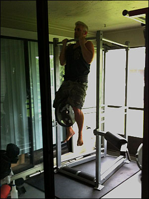 Drew Baye performing weighted chin-ups on the UXS