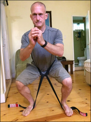 Steve Maxwell demonstrates a timed static contraction belt squat